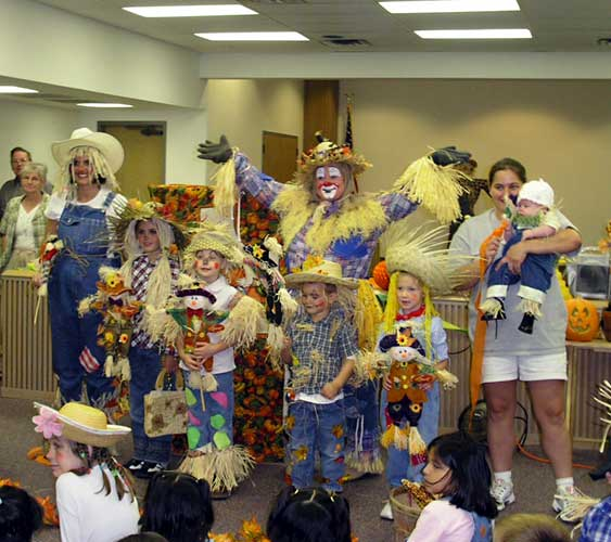 Photograph of Patchy with scarecrow costume contestants.